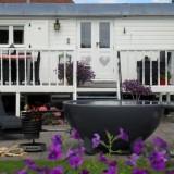 mammaloewagen-pipowagensuperdeluxe met hot-tub vakantiehuis op wielen buitengoed de gaard limburg